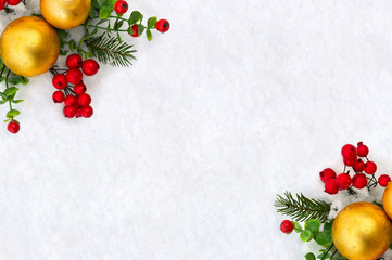 Christmas decoration. Twigs christmas tree, christmas yellow balls and red berries on snow with space for text. Top view, flat lay