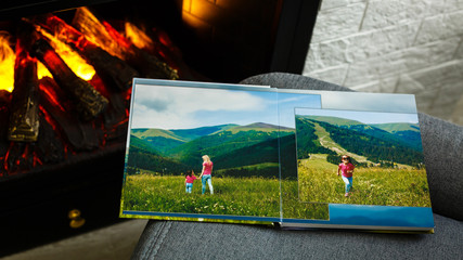 view open book with album at home