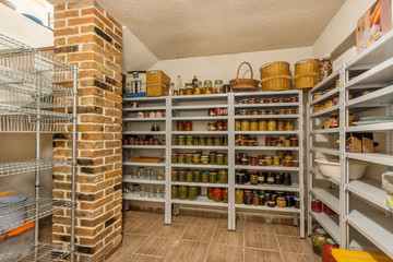 Home food storage room. Various jars with Home Canning Fruits and Vegetables jam on shelves