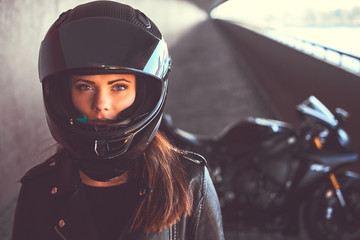 Close-up portrait of a biker girl inside the bridge.
