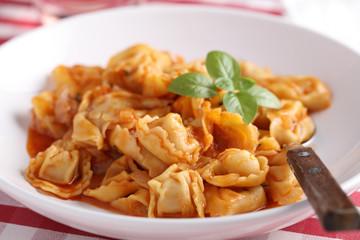 Ravioli under tomato sauce