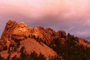 Acrylic Prints Light pink Mount Rushmore in the South Dakota Black Hills National Forest. Summertime with the warm glow of an early evening sun shining on the president's faces