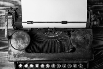 Aged typewriter with a blank paper