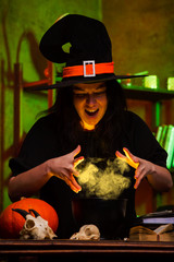 Photo of witches saucepans with magic potion in dark room