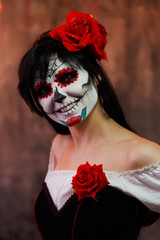 Portrait of woman halloween with white make-up on her face