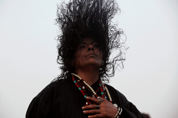 A devotee dances at the shrine of Data Ganj Bakhsh, during a festival in Lahore