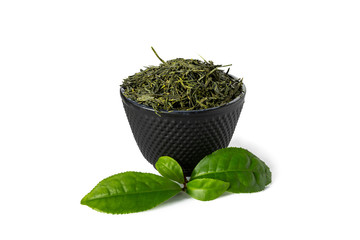Green sencha tea in black cast iron cup