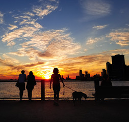 silhouettes of people at sunset