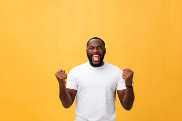 Handsome young Afro-American man employee feeling excited, gesturing actively, keeping fists clenched, exclaiming joyfully with mouth wide opened, happy with good luck or promotion at work Fototapete
