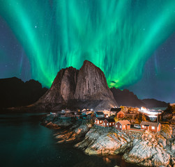 Northern Lights Aurora Borealis with classic view of the fisherman s village of Hamnoy, near Reine in Norway, Lofoten islands. This shot is powered by a wonderful Northern Lights show.