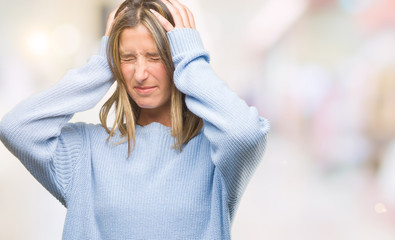 Young beautiful woman wearing winter sweater over isolated background suffering from headache desperate and stressed because pain and migraine. Hands on head.