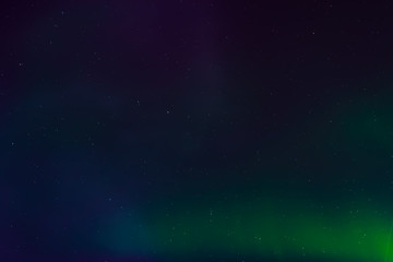 Aurora borealis, northern lights in the night sky with stars