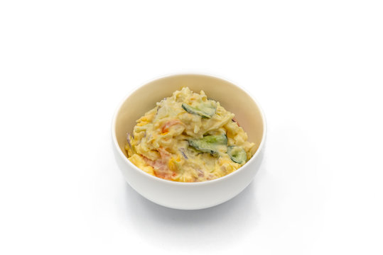 Japanese Potato Salad With Cucumbers, Carrots, and Onion in a bowl isolated on the white