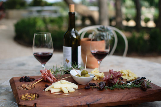 Meat and Cheese Board With Wine Glasses At a Winery