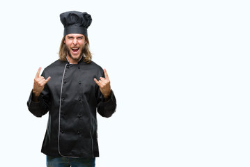 Young handsome cook man with long hair over isolated background shouting with crazy expression doing rock symbol with hands up. Music star. Heavy concept.