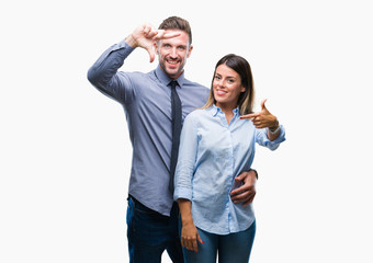 Young workers business couple over isolated background smiling making frame with hands and fingers with happy face. Creativity and photography concept.
