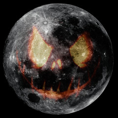 Big Moon in full phase transformed in a halloween pumpkin face in black background.