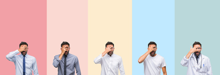 Collage of handsome man over colorful stripes isolated background peeking in shock covering face and eyes with hand, looking through fingers with embarrassed expression.