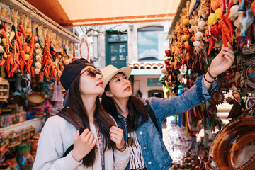 pretty backpackers buying chili decorations