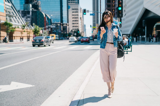 office lady waiting beside the road after work