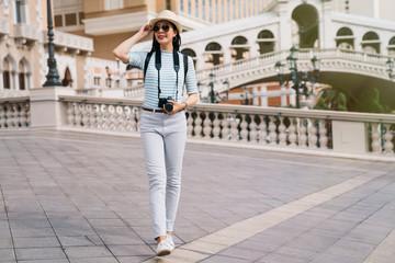full length photo of traveler walking on bridge