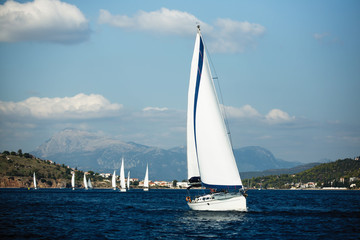 Wall Mural - Greece sailing yacht boat at the Sea. Regatta and luxury cruise yachting.