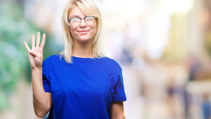 Young beautiful blonde woman wearing glasses over isolated background showing and pointing up with fingers number four while smiling confident and happy.