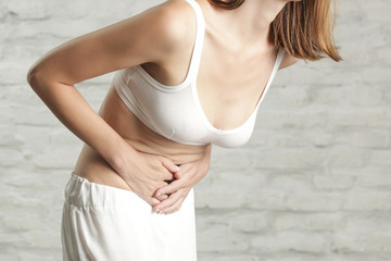 Woman having painful stomachache, chronic gastritis or abdomen bloating