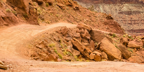 Curving off road trail by the cliffs in Moab Utah
