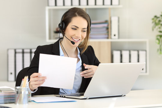 Telemarketer attending a call at office