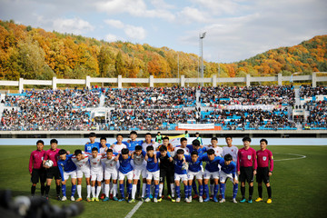 South and North Korea's youths have a group photo before a soccer game during the 5th Ari Sports Cup in Chuncheon