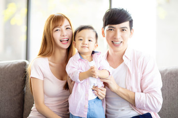 happy family mother and father  with baby at home