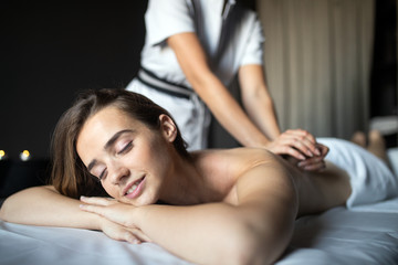 Young woman having massage in beauty salon