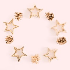 Christmas composition. Xmas gold decorations on pastel pink background. Flat lay, top view, copy space