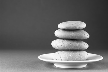 Fototapete - Stack of grey massage stones