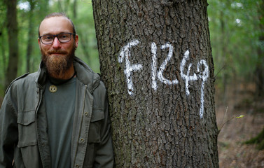 "Tango, 28, student of ecological agriculture and environmental activist poses for a picture at ""Jelka"" tree house colony in the forest ""Hambacher Forst"" west of Cologne"