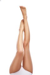 Beautiful long woman legs on white background, copyspace