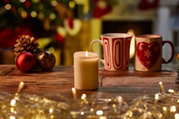 Christmas still life with candle and fireplace