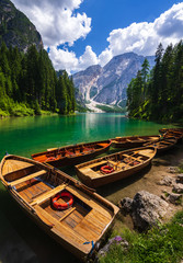 Wooden boat at lake Braies, Dolomites mountains, Italy