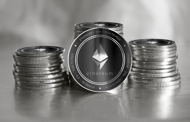 Ethereum (ETH) digital crypto currency. Stack of black and silver coins. Cyber money.