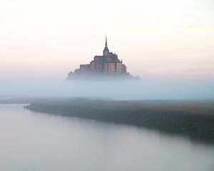 Mount Saint Michel, Normandy, France, during a foggy sunrise