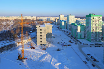 Construction site and a crane on a winter's day in Novosibirsk