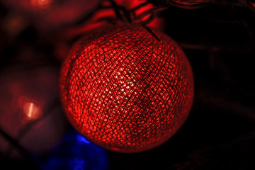 Glowing ball of on Christmas tree
