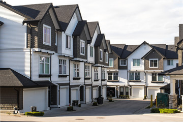 Nice and comfortable neighborhood. Townhouses in the suburbs of Canada. Booming real estate.