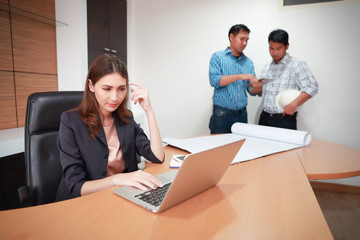 businesswoman using computer and working with engineer