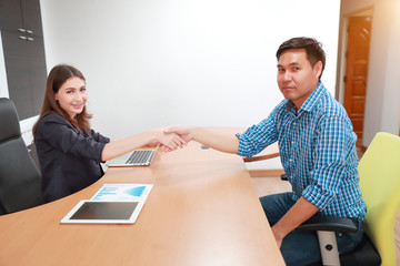 shaking hand between success businessman and businesswoman