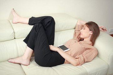 young woman sleeping on sofa in living room