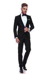 young groom opening his tuxedo