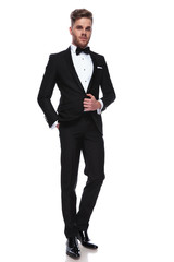 full body picture of a young elegant man in tuxedo