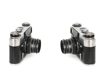 Two old cameras on white background